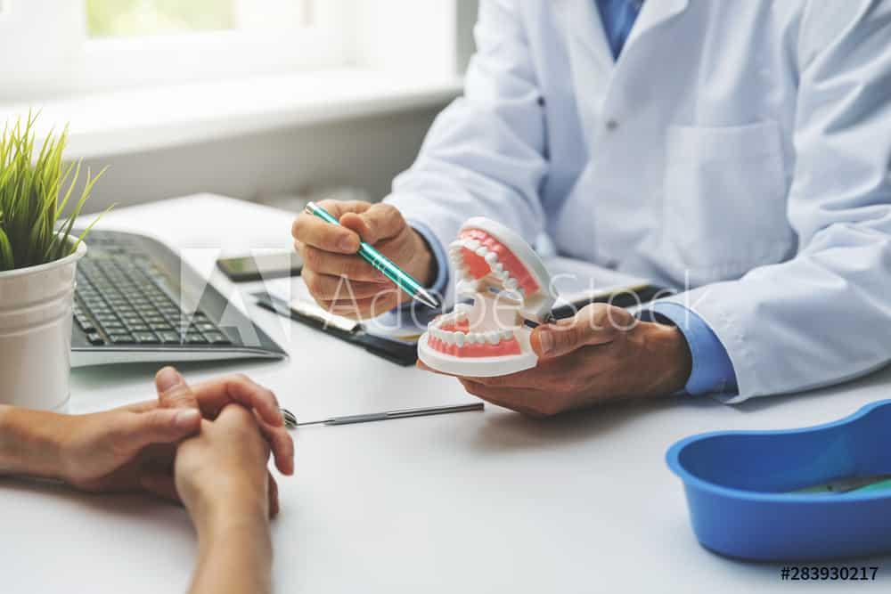 dental specialist explaining treatment