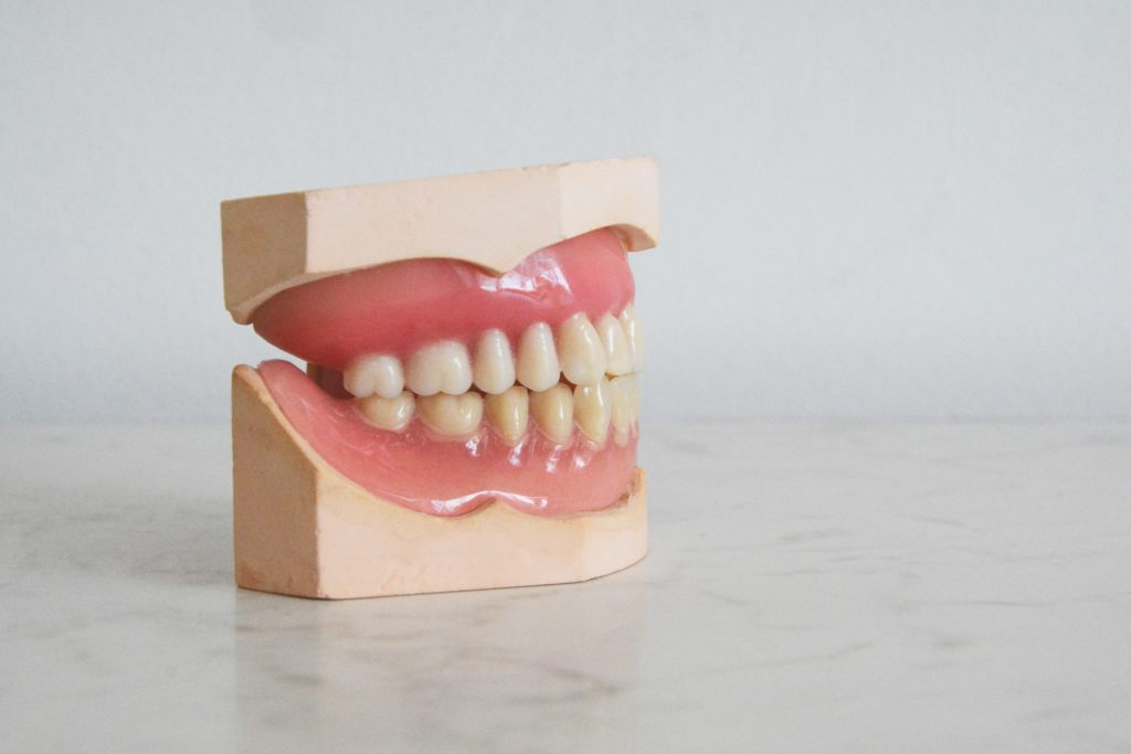 Deep cleaning teeth.