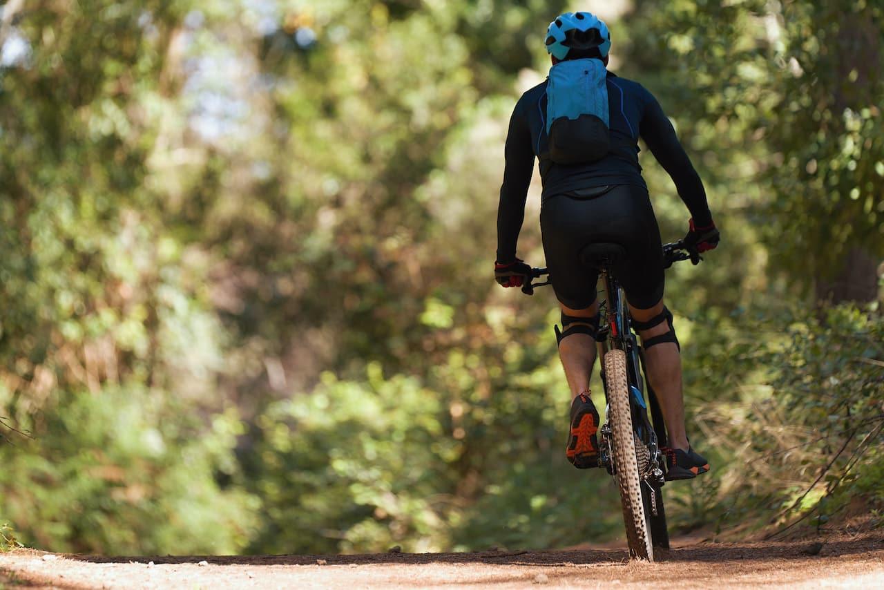 man biking on a trail in wayzata minnesota